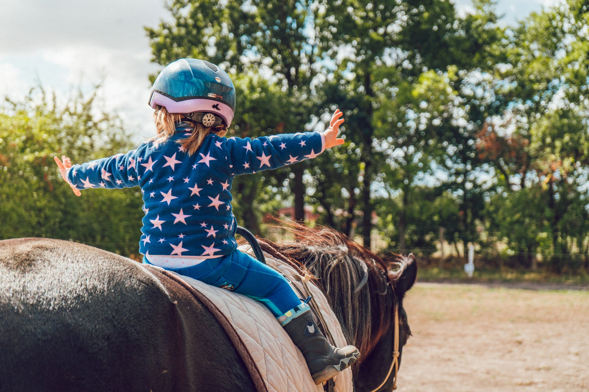little girl riding the horse