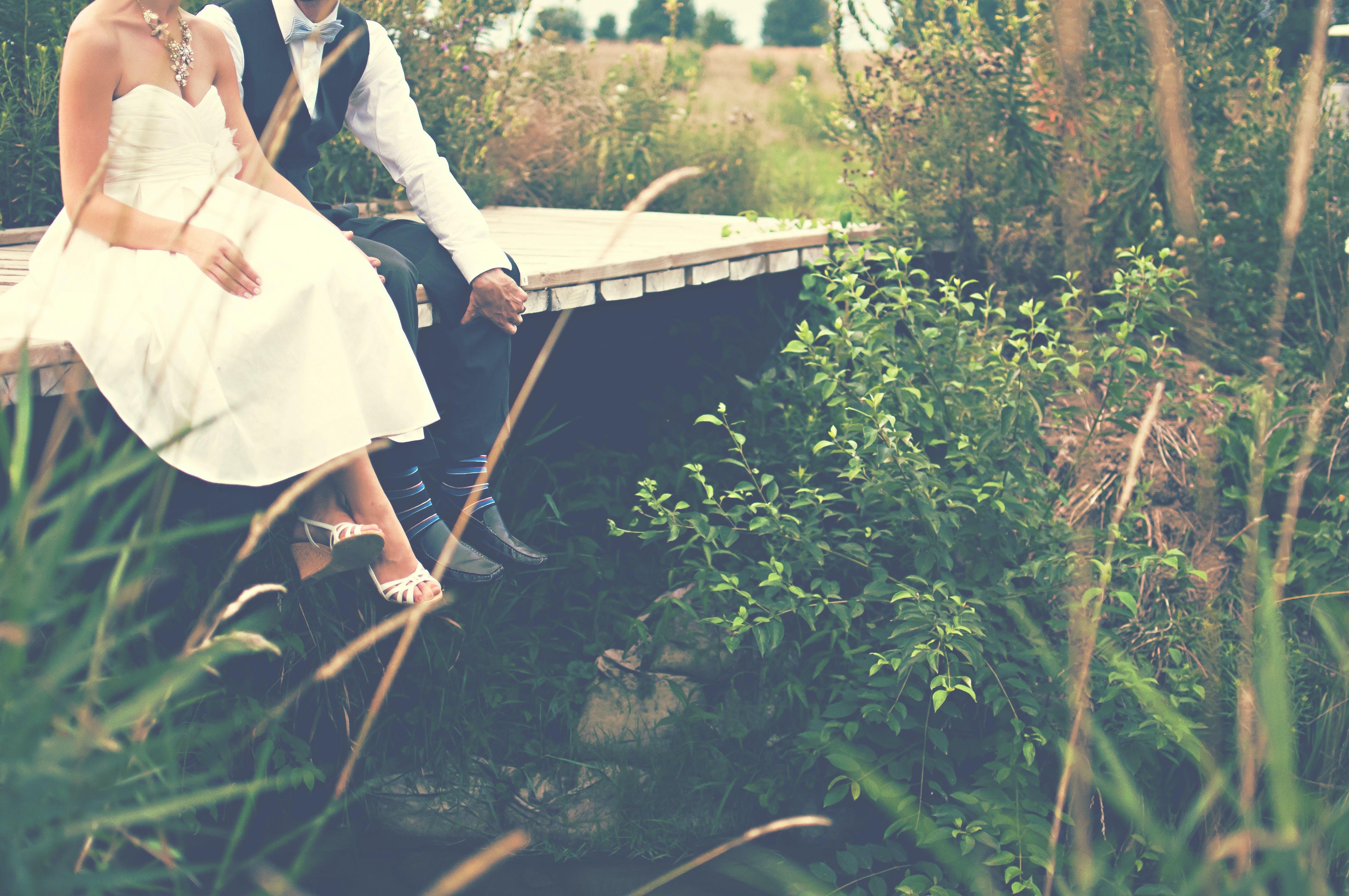 Man and Woman Seating on Bridge