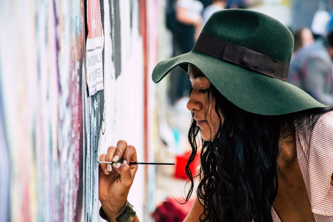 Woman Painting on a Wall
