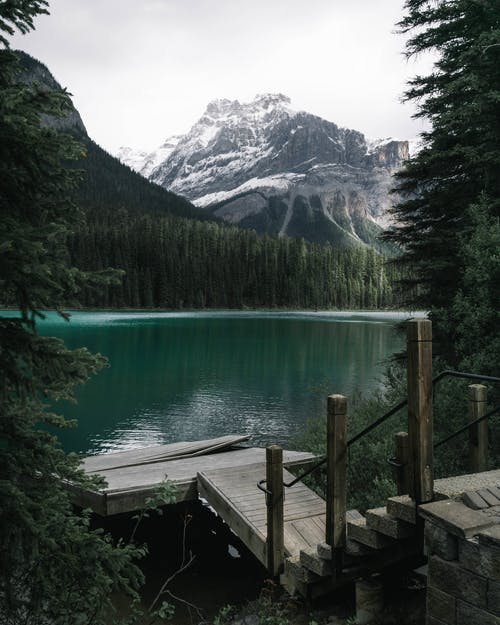 Body of Water Near Snow-capped Mountain