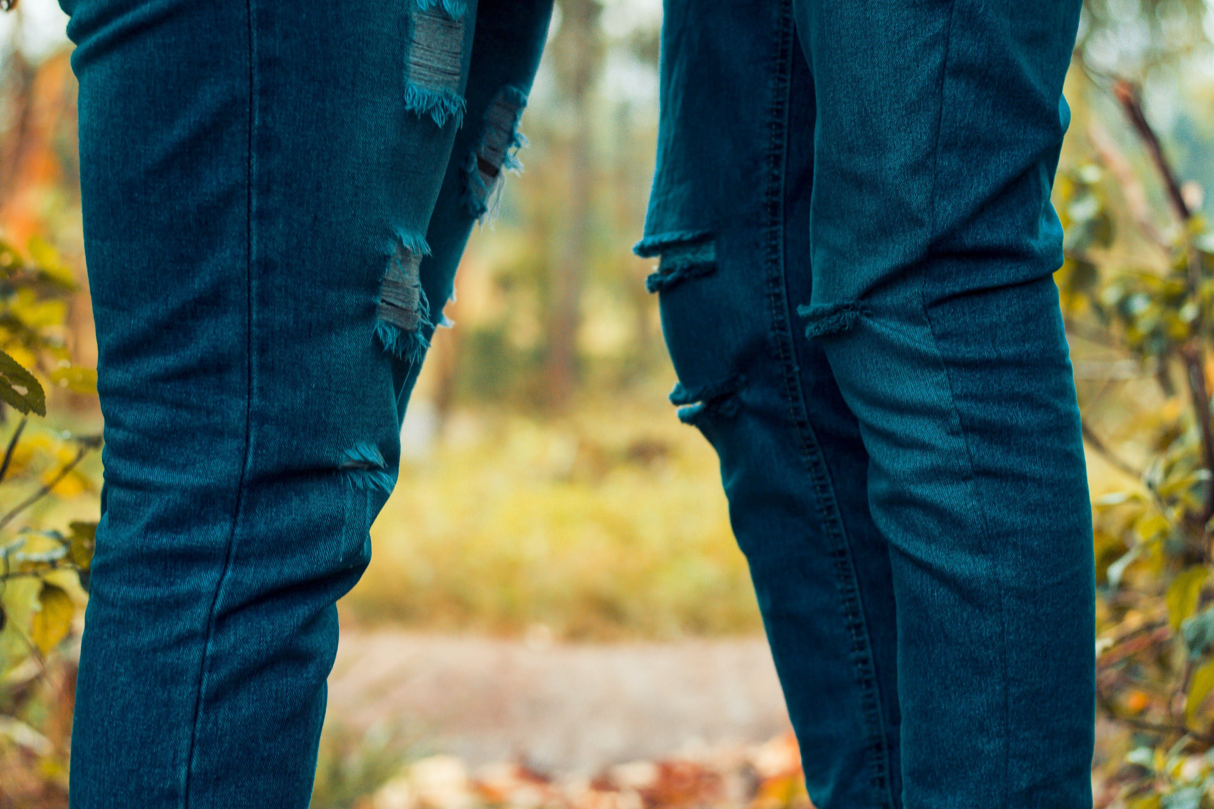 Two People Wearing Rugged Jeans