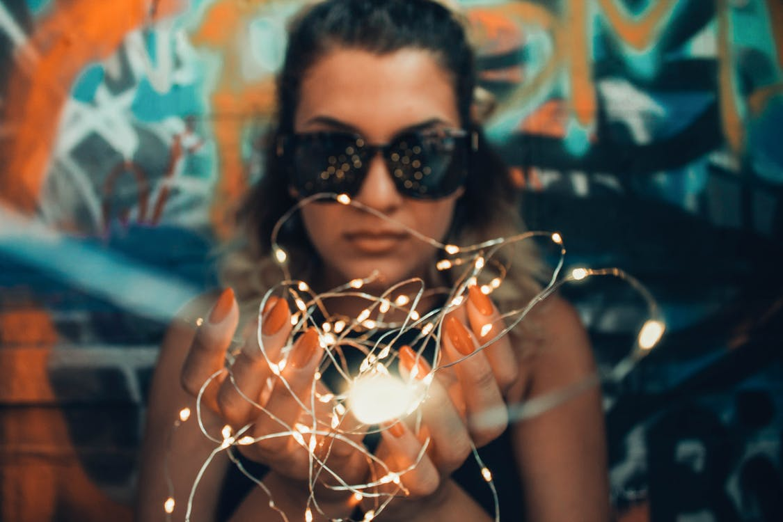 Woman Holding White String Lights