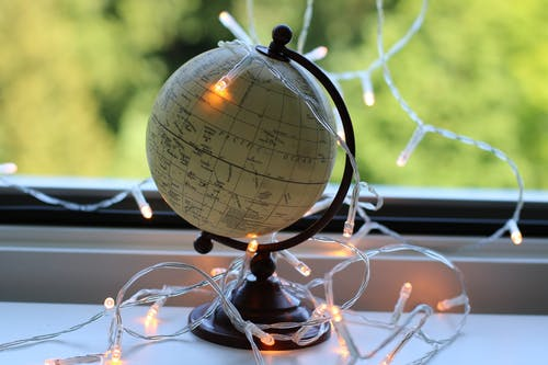 White And Black Desk Globe With White String Lights