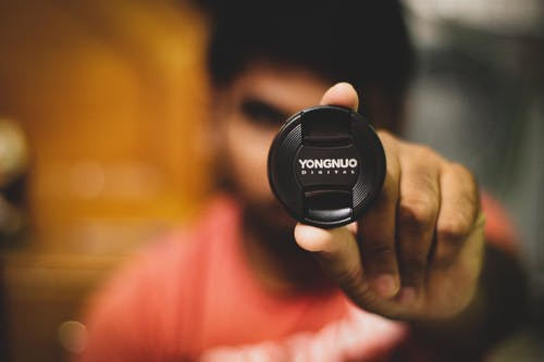 Person Holding Yongnuo Lens Tip