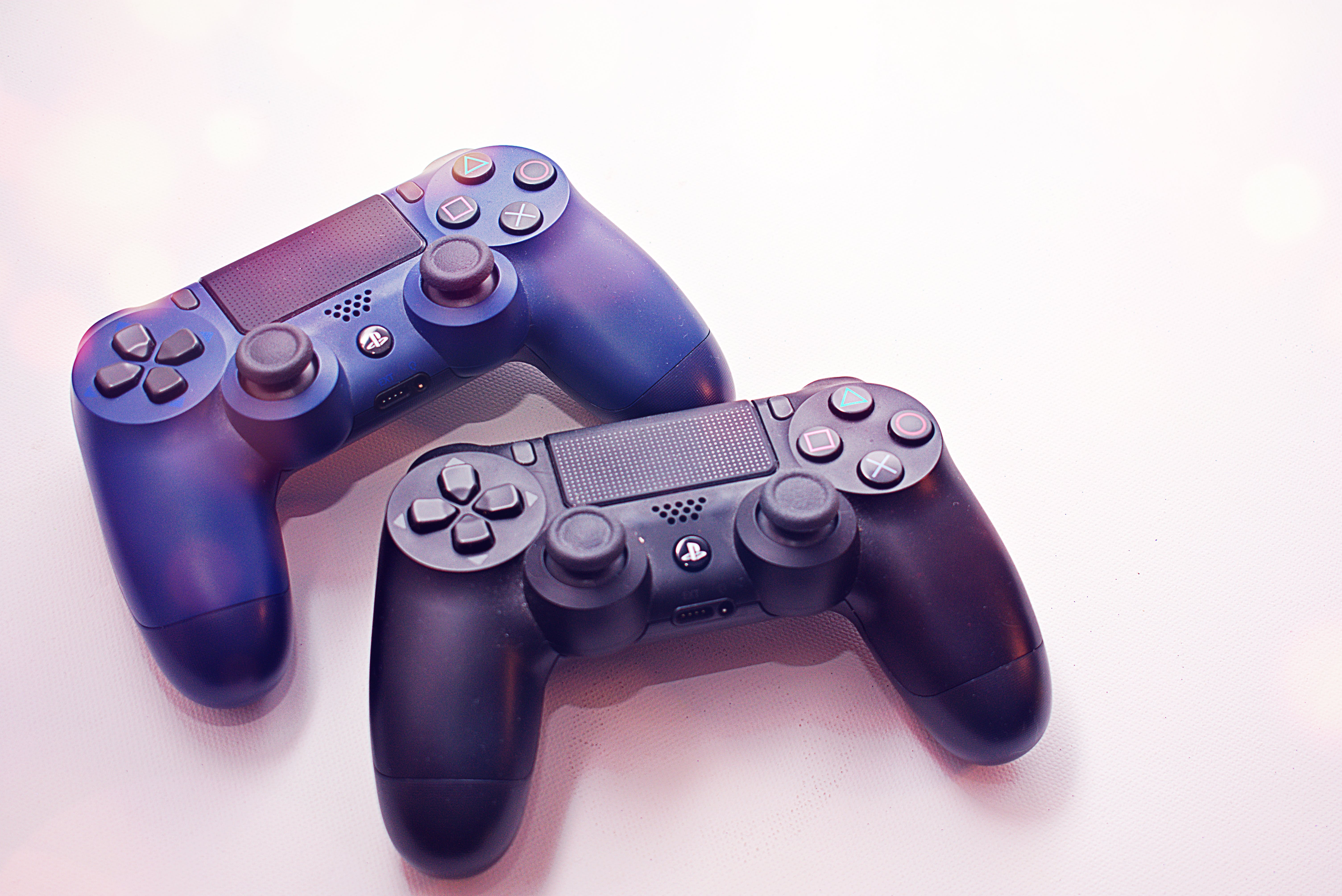 Sony Ps4 Wireless Controllers On White Surface