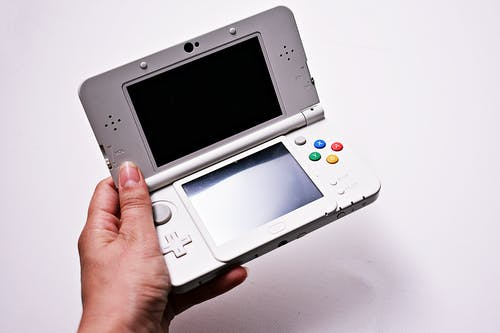 Person Holding Gray Nintendo Gameboy Advance