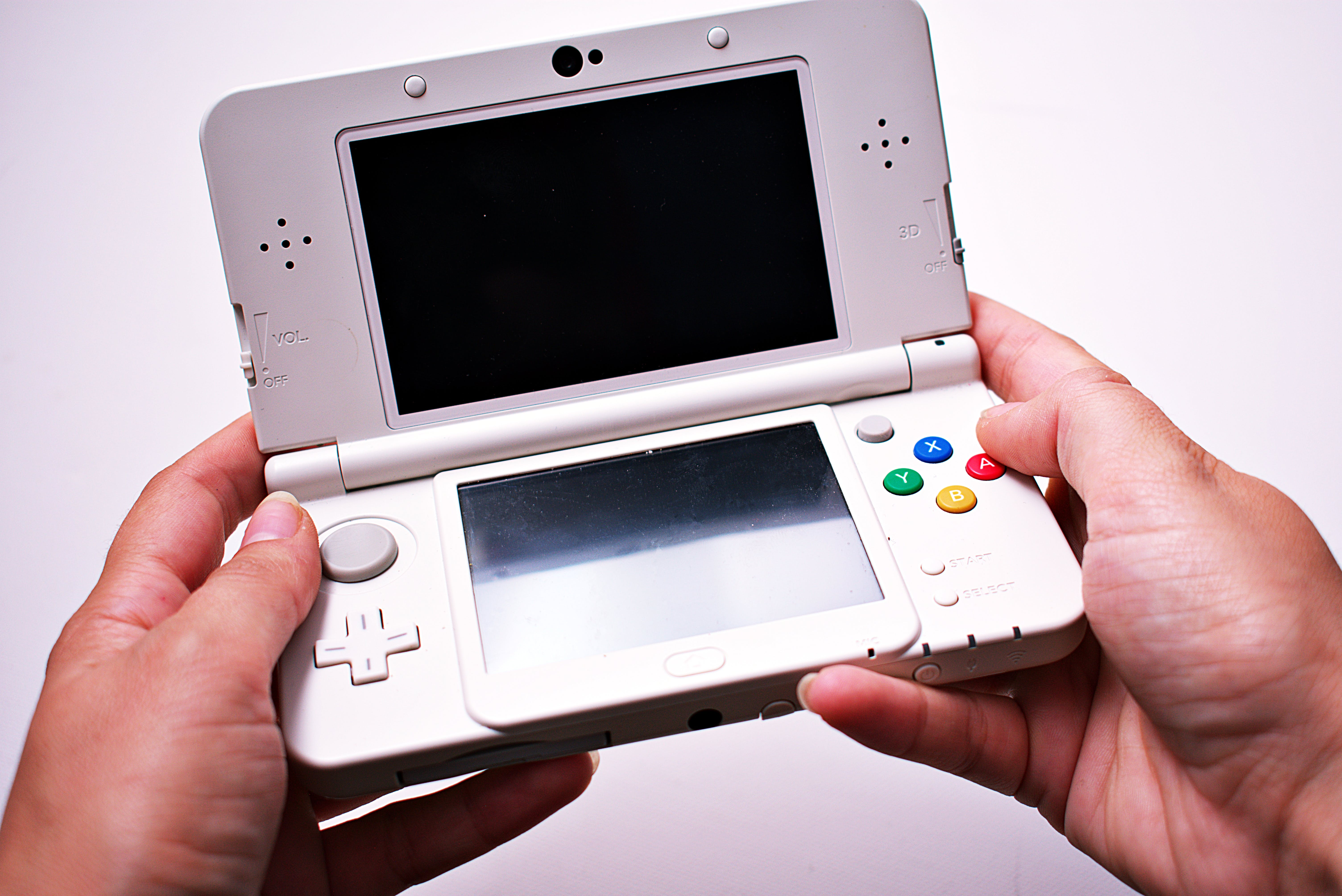 Person Holding Nintendo Ds