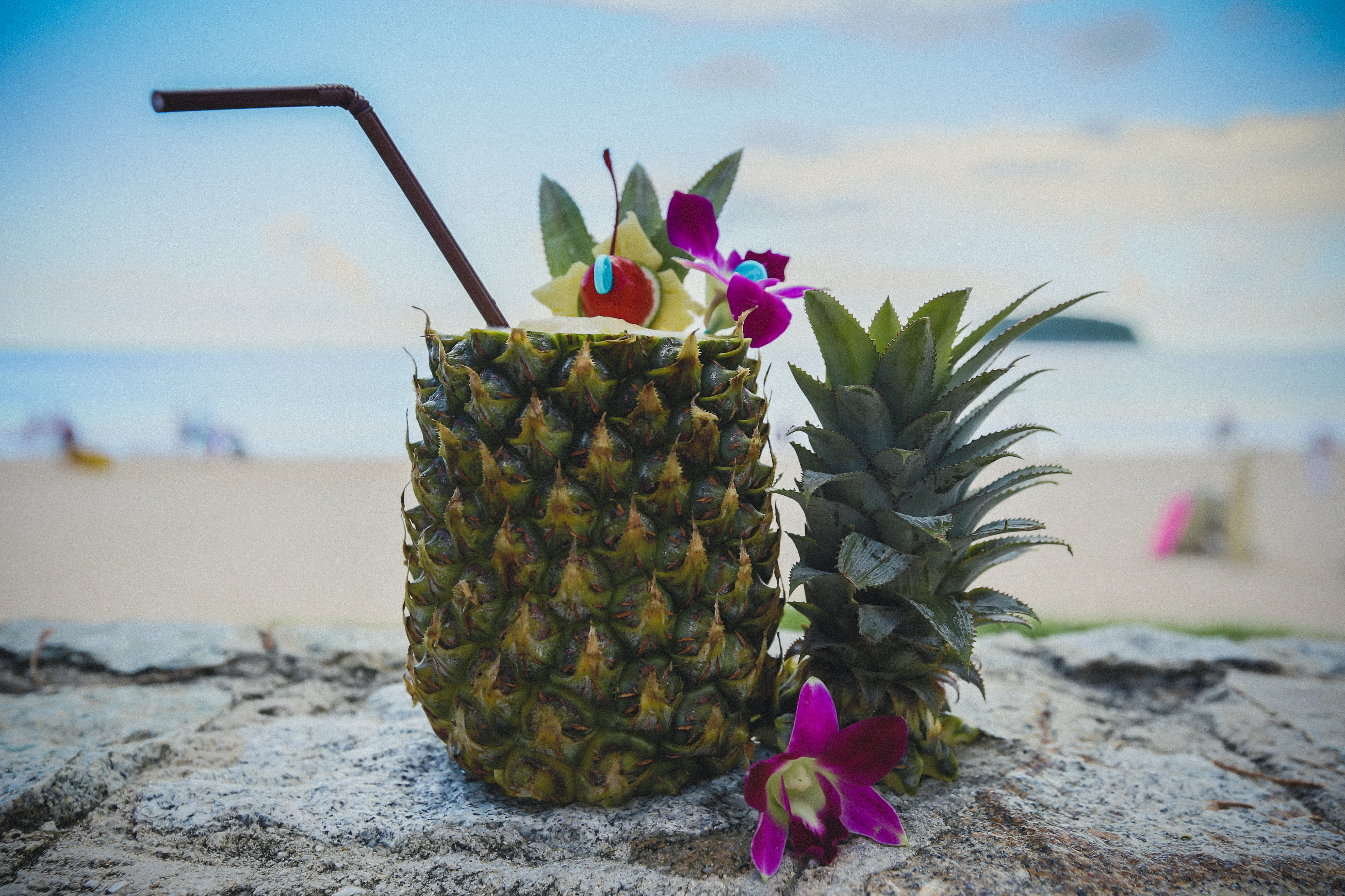 tropical cocktail in a carved-out pineapple