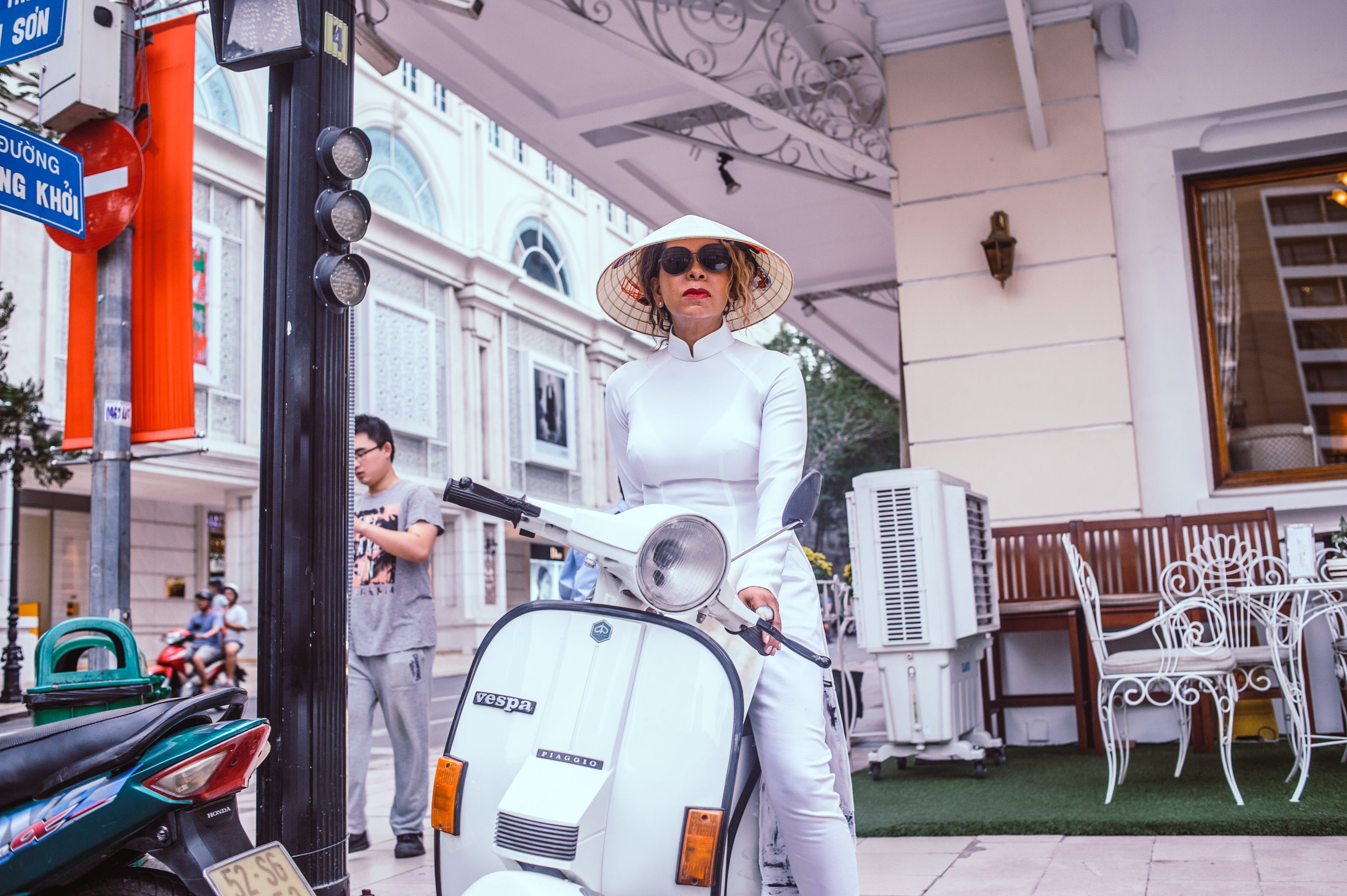 Woman Sitting on Motor Scooter