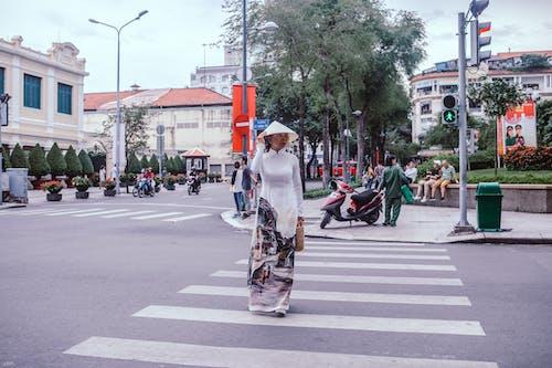 Photos gratuites de ao dai, beauté, citadin, femme