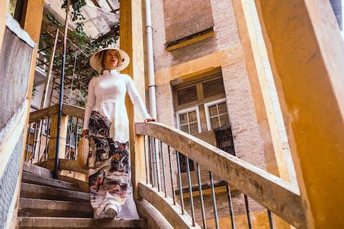 Foto d'estoc gratuïta de Áo dài, arquitectura, bellesa, bonic