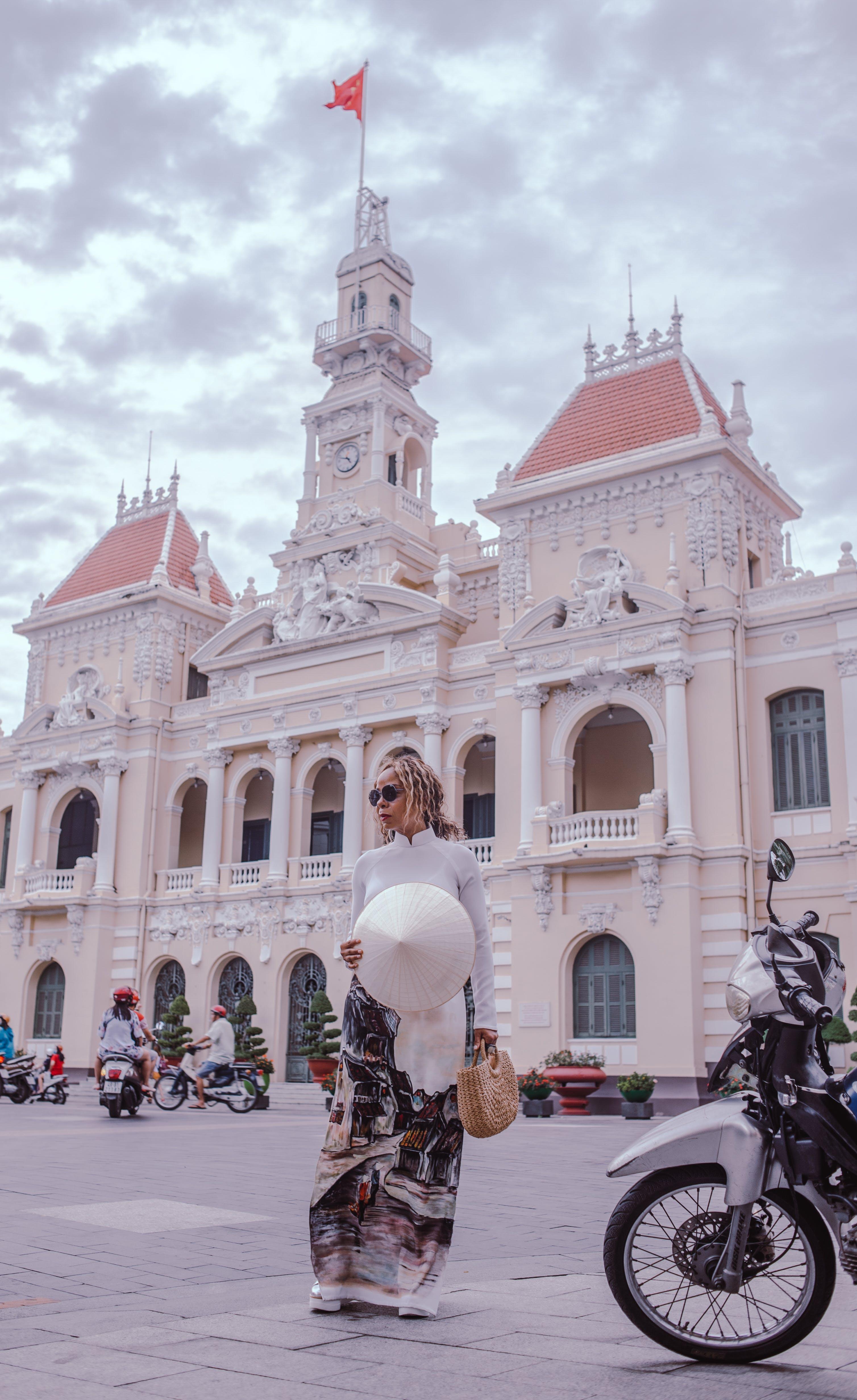 Woman Standing Beside Motorcycle