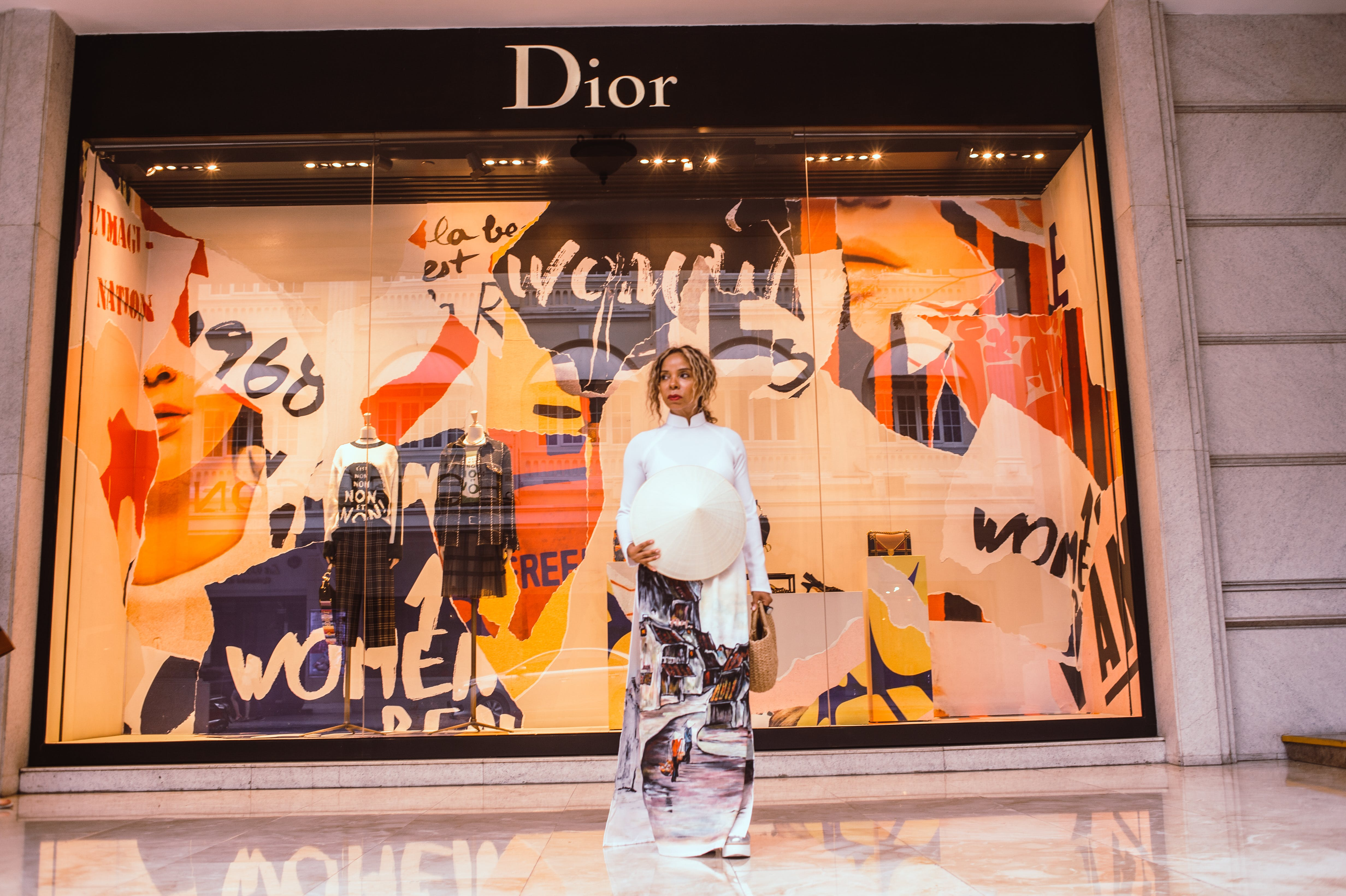 Woman Standing in Front of Dior Store Front