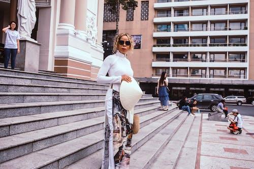 Woman Standing Near Statue