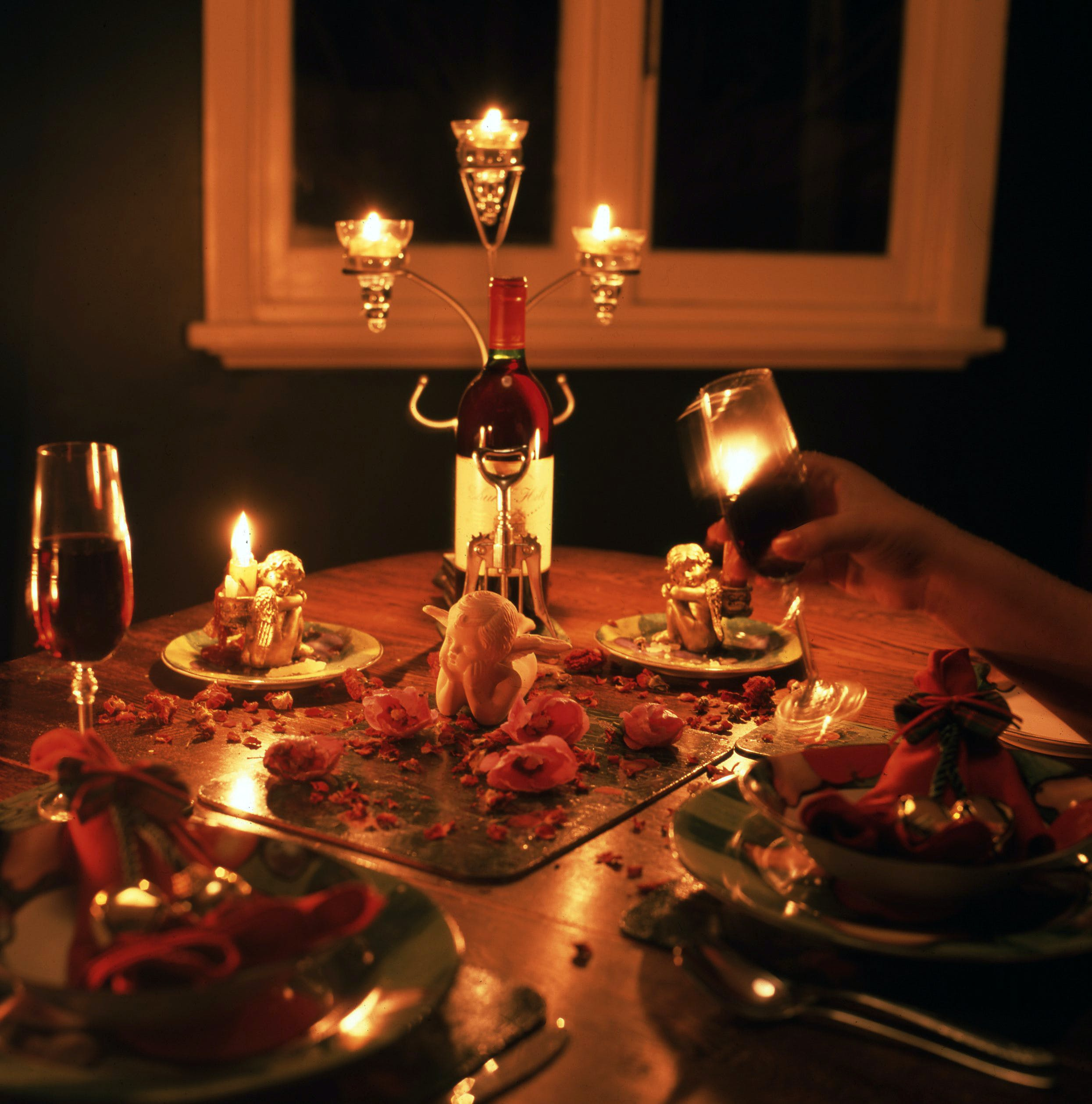 candlelight, dinner table, glass of wine