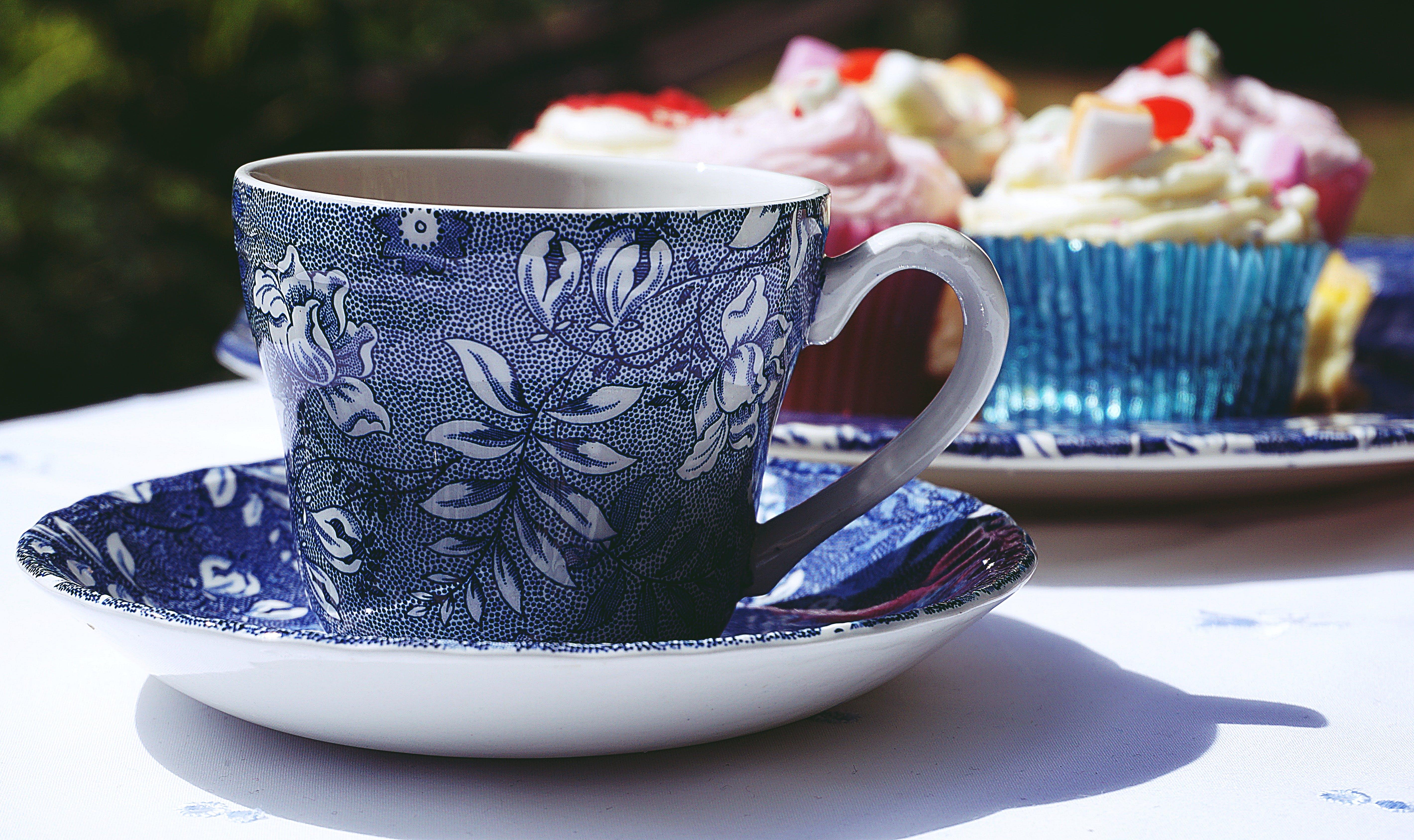Blue And White Ceramic Mug And Saucer