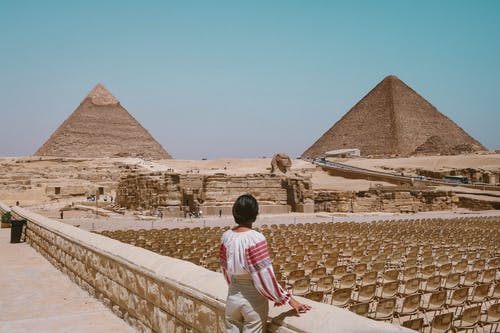Woman Looking At Pyramids