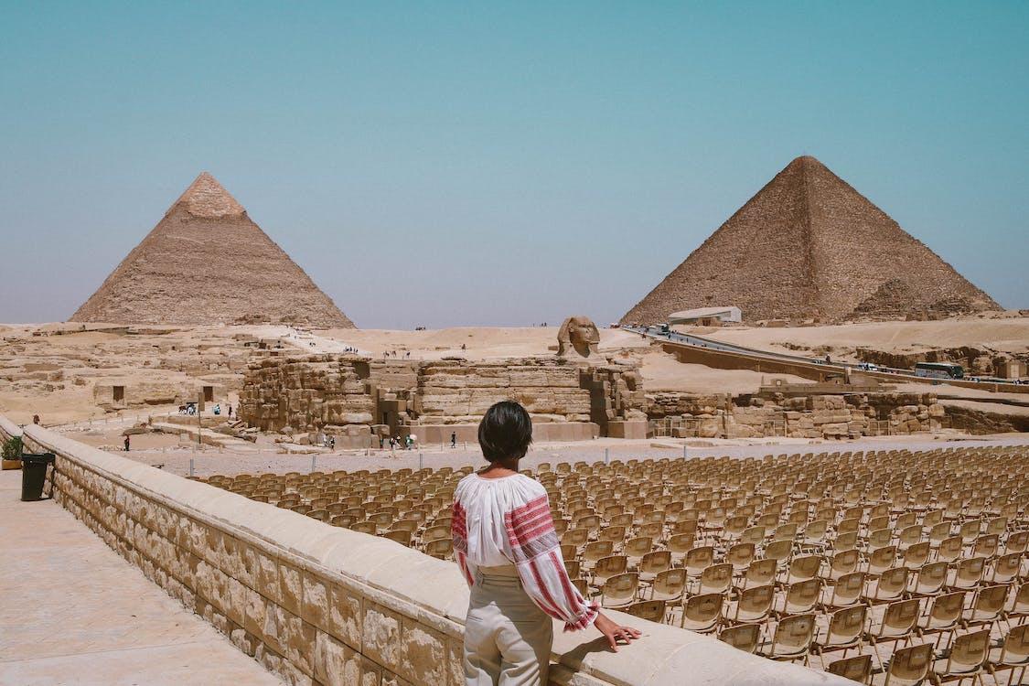 Woman Looking At Pyramids