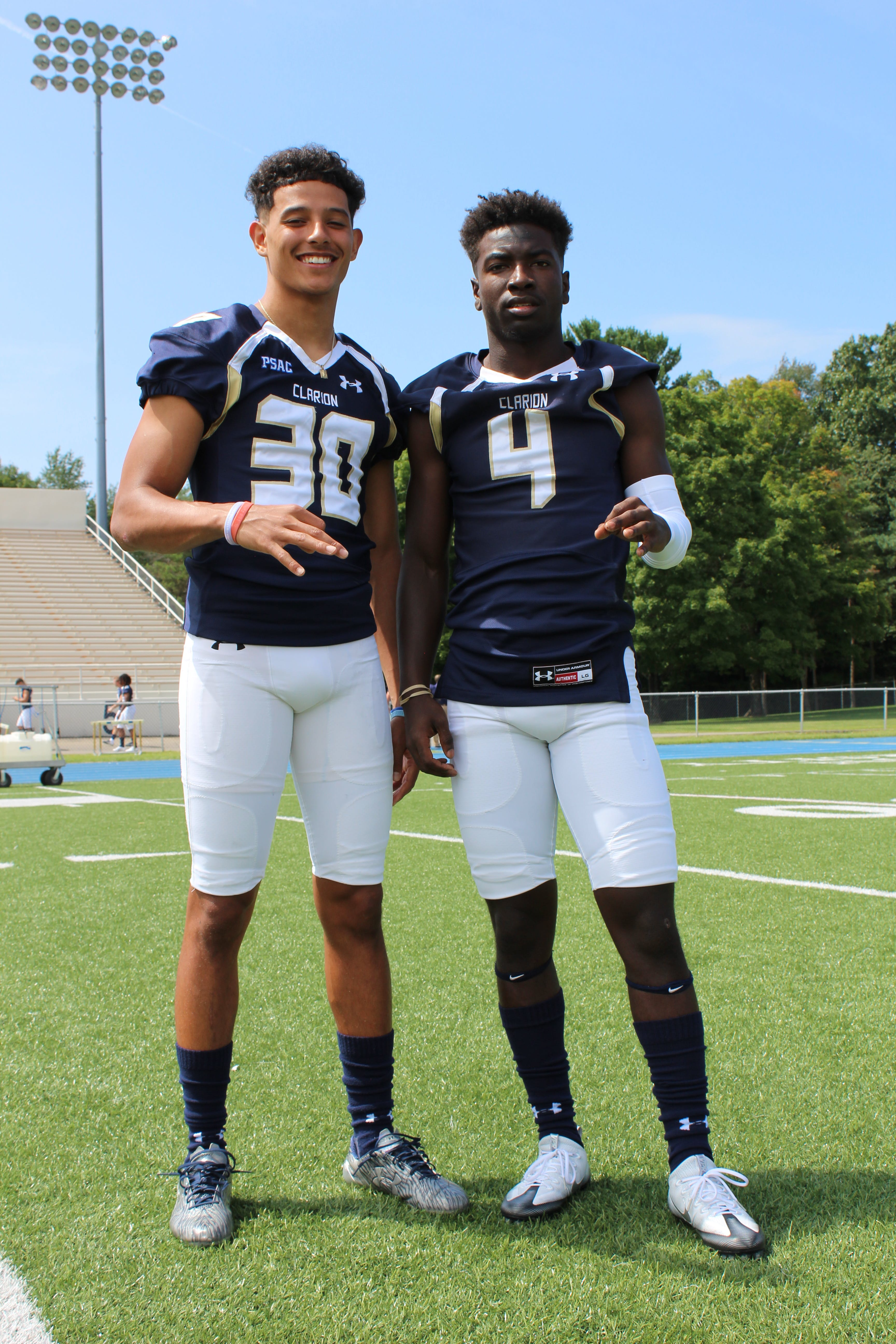 Two Football Players Taking Picture on Football Field