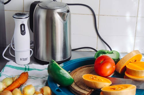 Gray Metal Electric Kettle Near Sliced Vegetables
