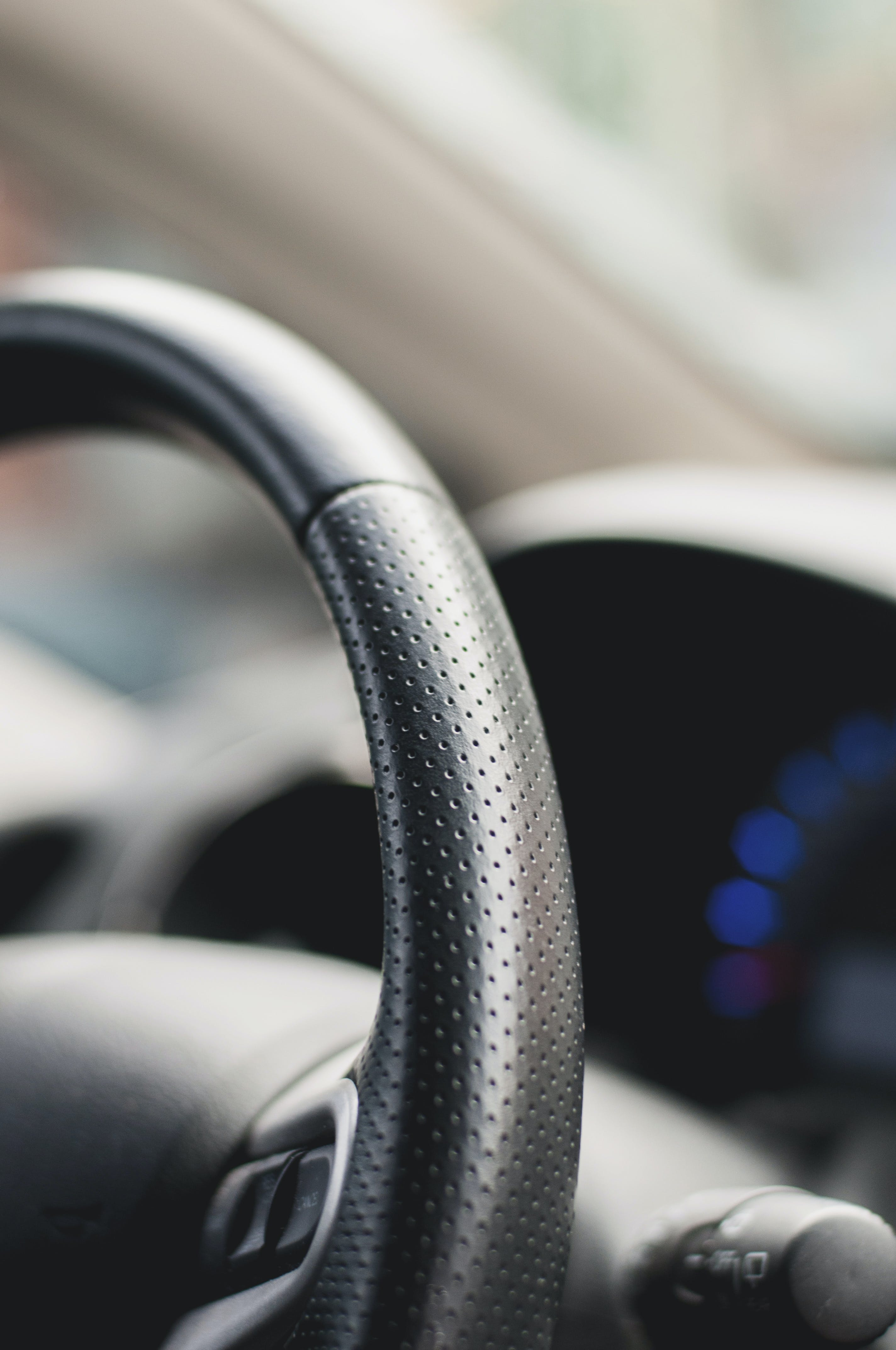 Black Car Steering Wheel Shallow Focus Photography