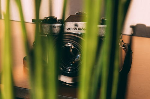 Shallow Focus Photography of Black and Gray Dslr Camera
