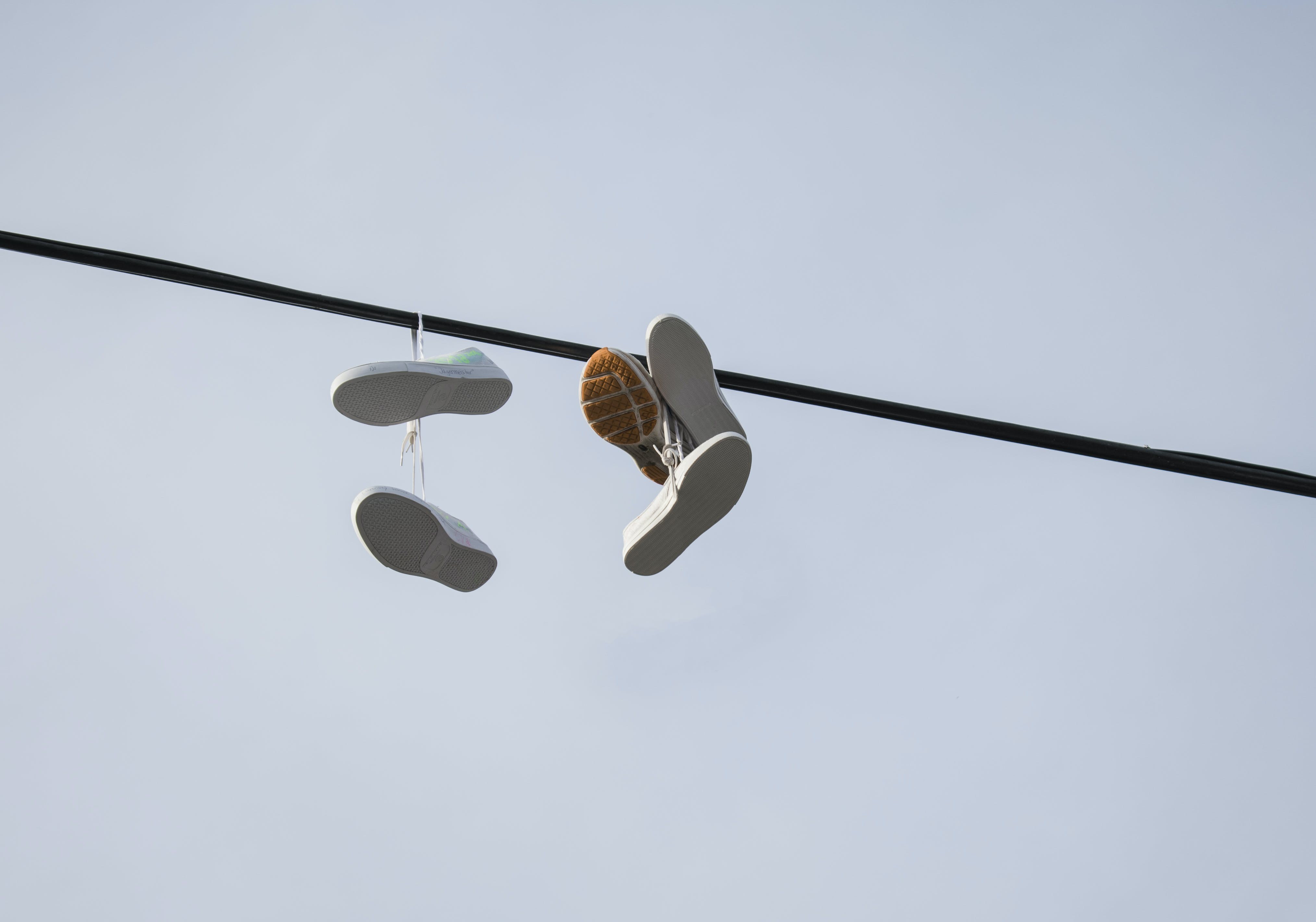 Shoes Hanged on Black Pole