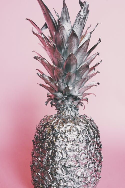 Close-up Photo of Silver Painted Pineapple Against Pink Background