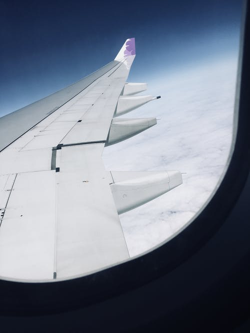 View of Airplane Wings from Inside a Plane