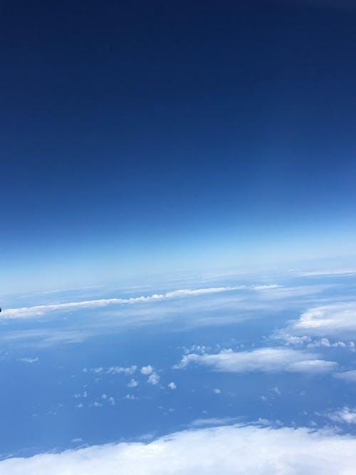 Gratis lagerfoto af flyvemaskine, skyer, stillehavet