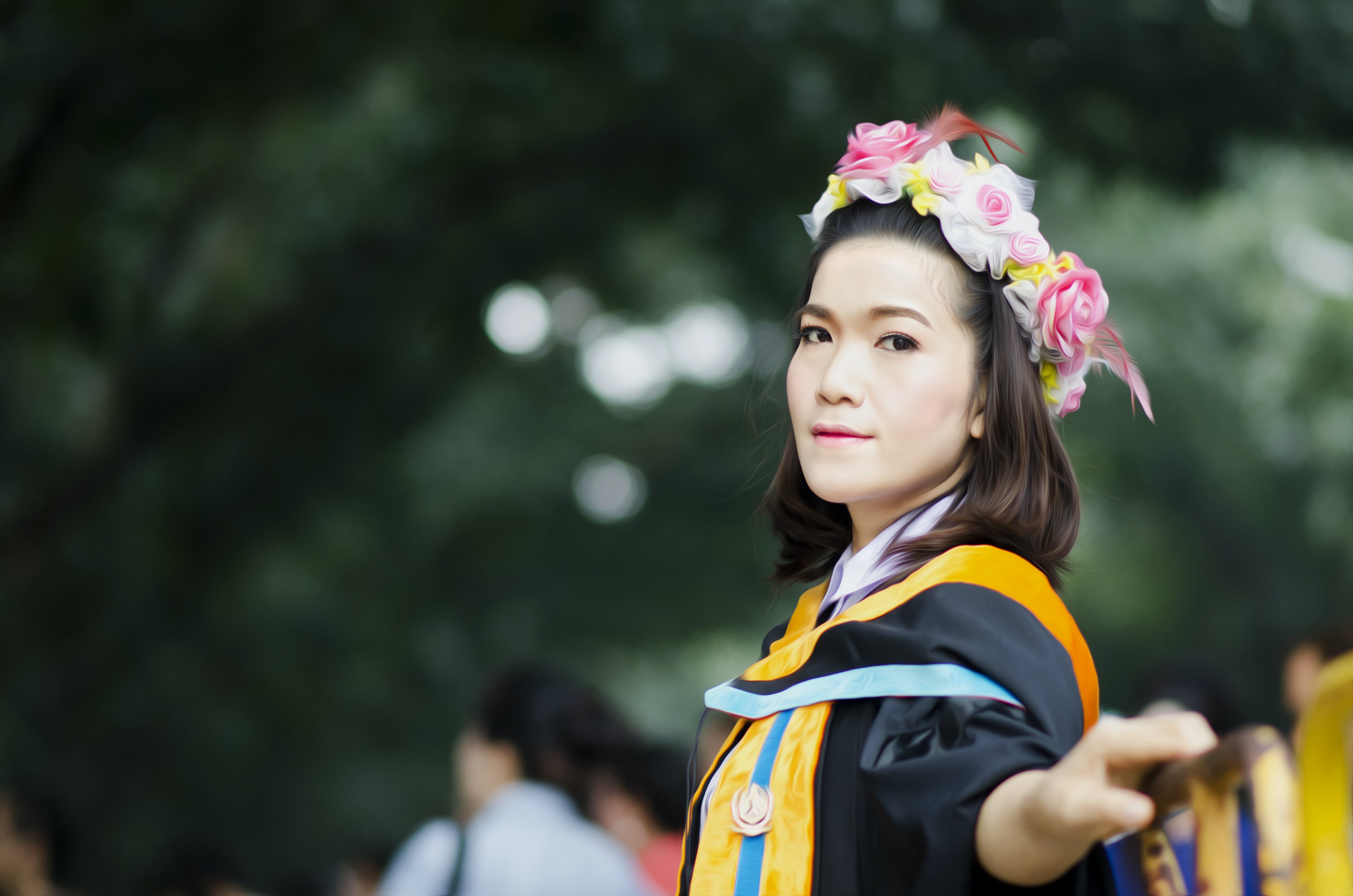 Selective Focus Photography of Woman Wearing Academic Gown Near Green Trees