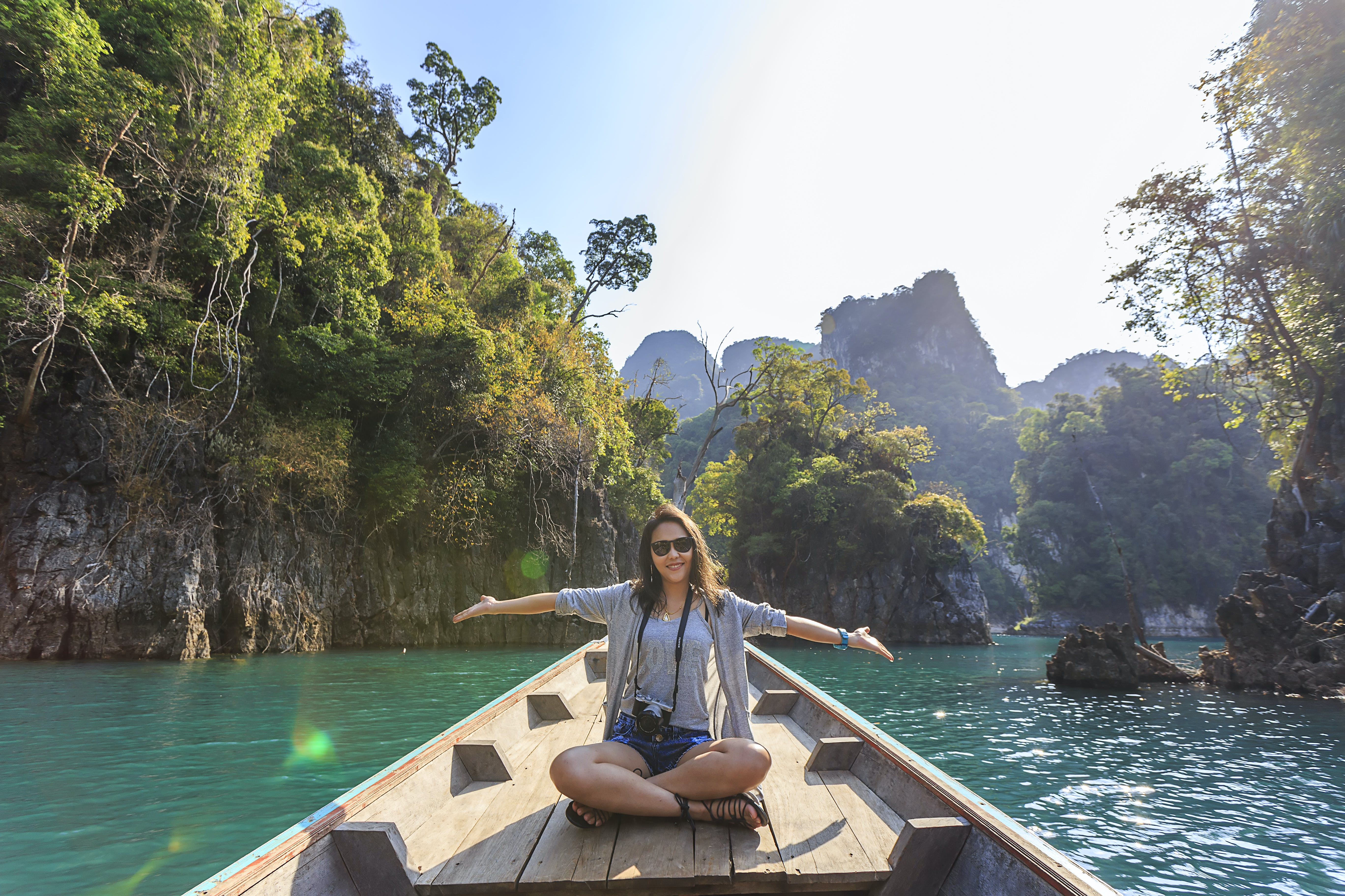Photo of Woman Sitting on Boat Spreading Her Arms
