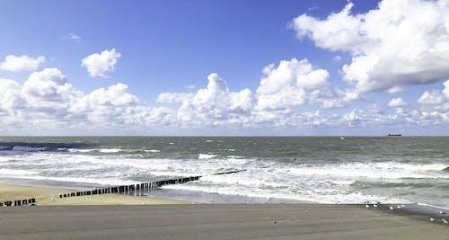 Gratis arkivbilde med blå himmel, hav, nederland, skyer