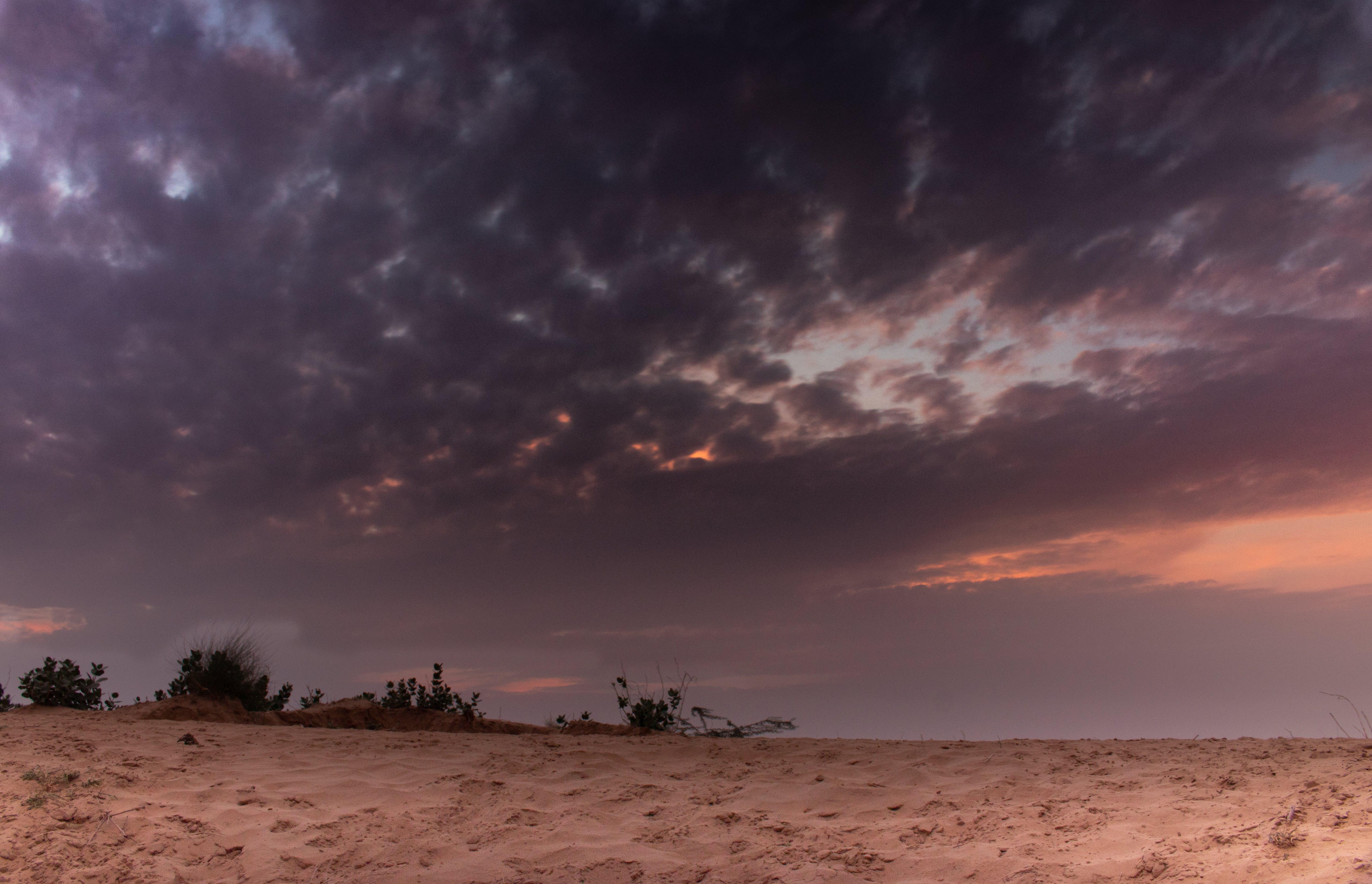 Sand Under Cloudy Skies