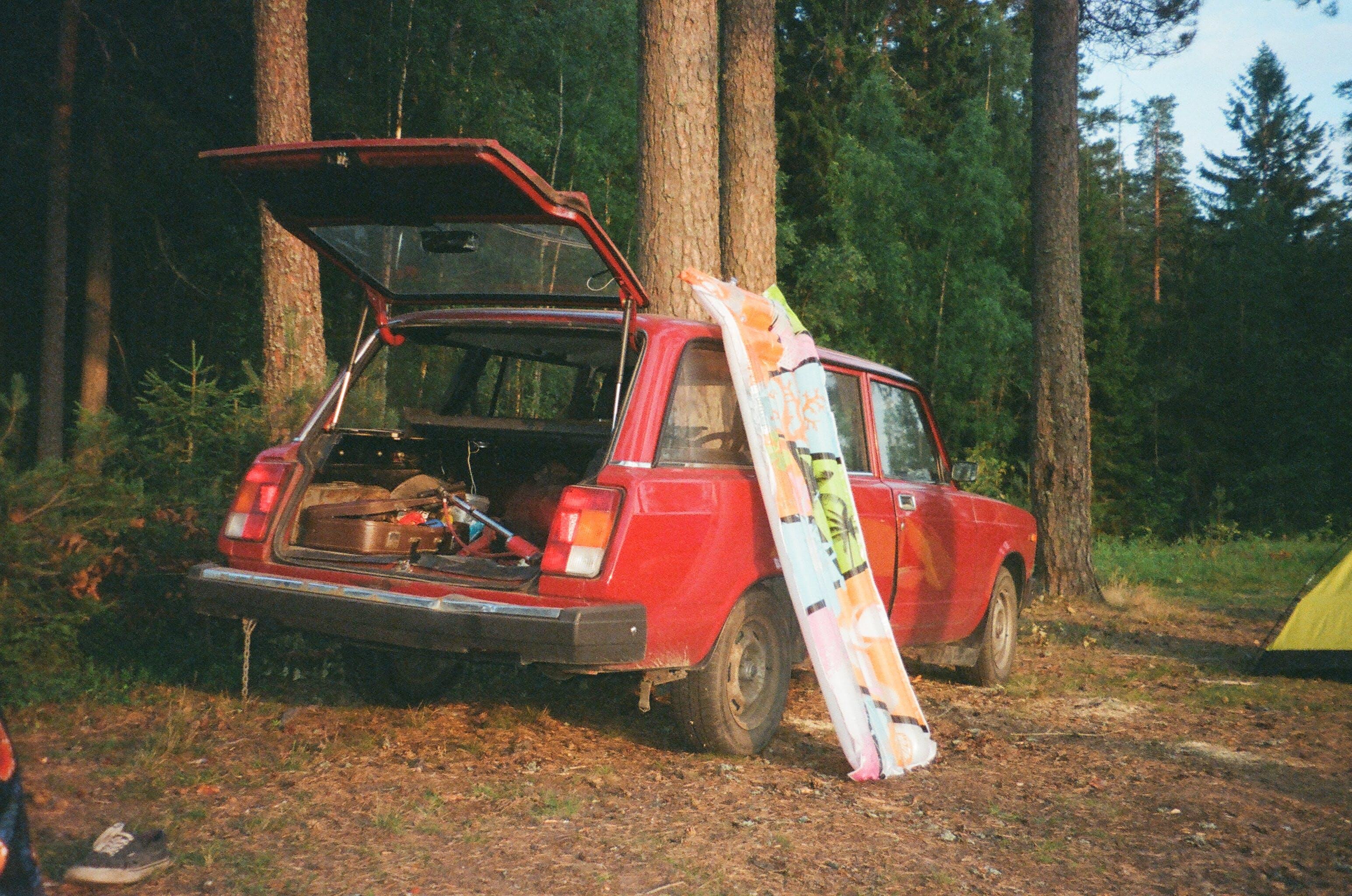 Opened Rear Door of Red 3-door Hatchback Parked Near Trees