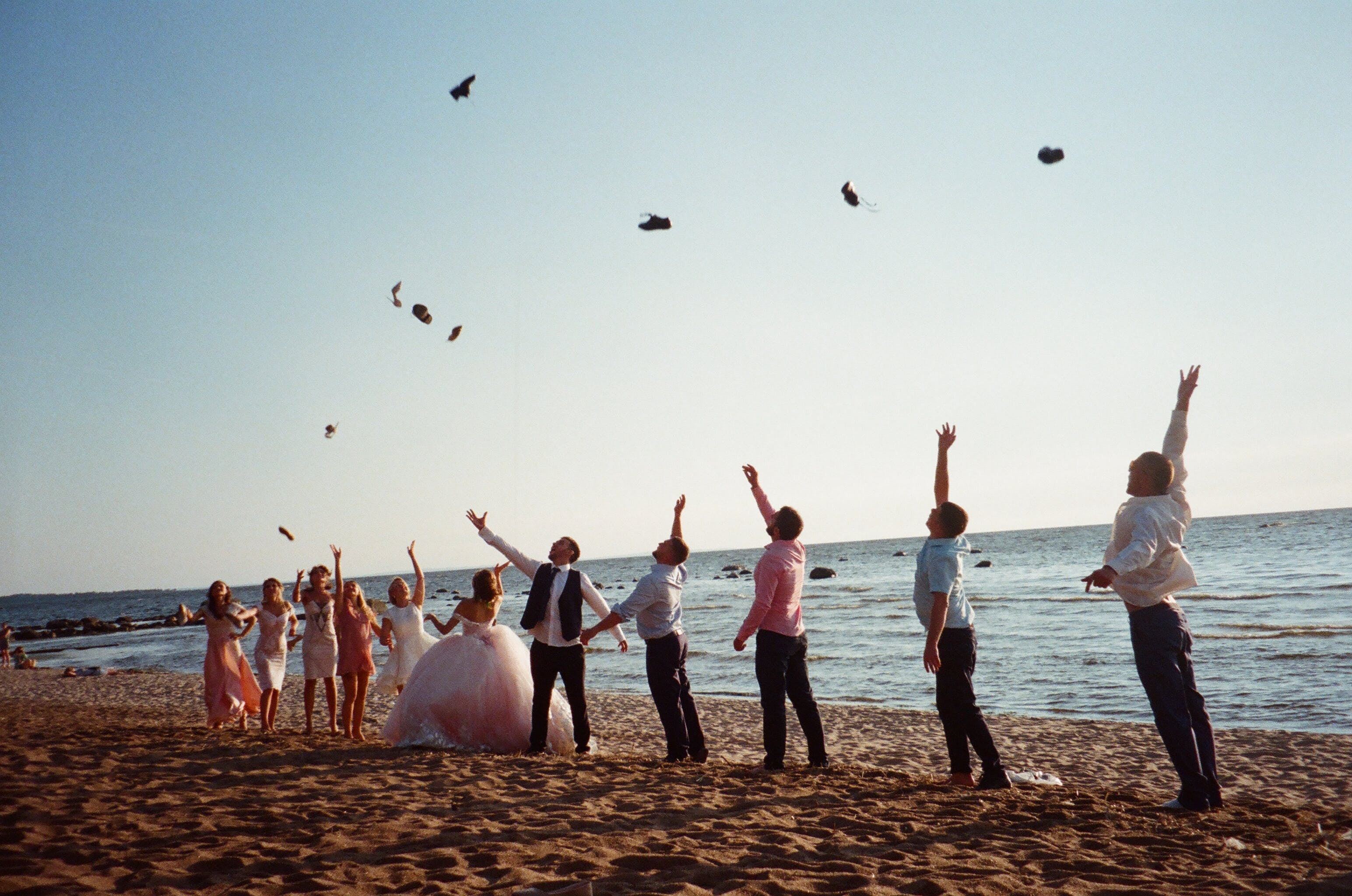 People Throwing Things Near the Seashore