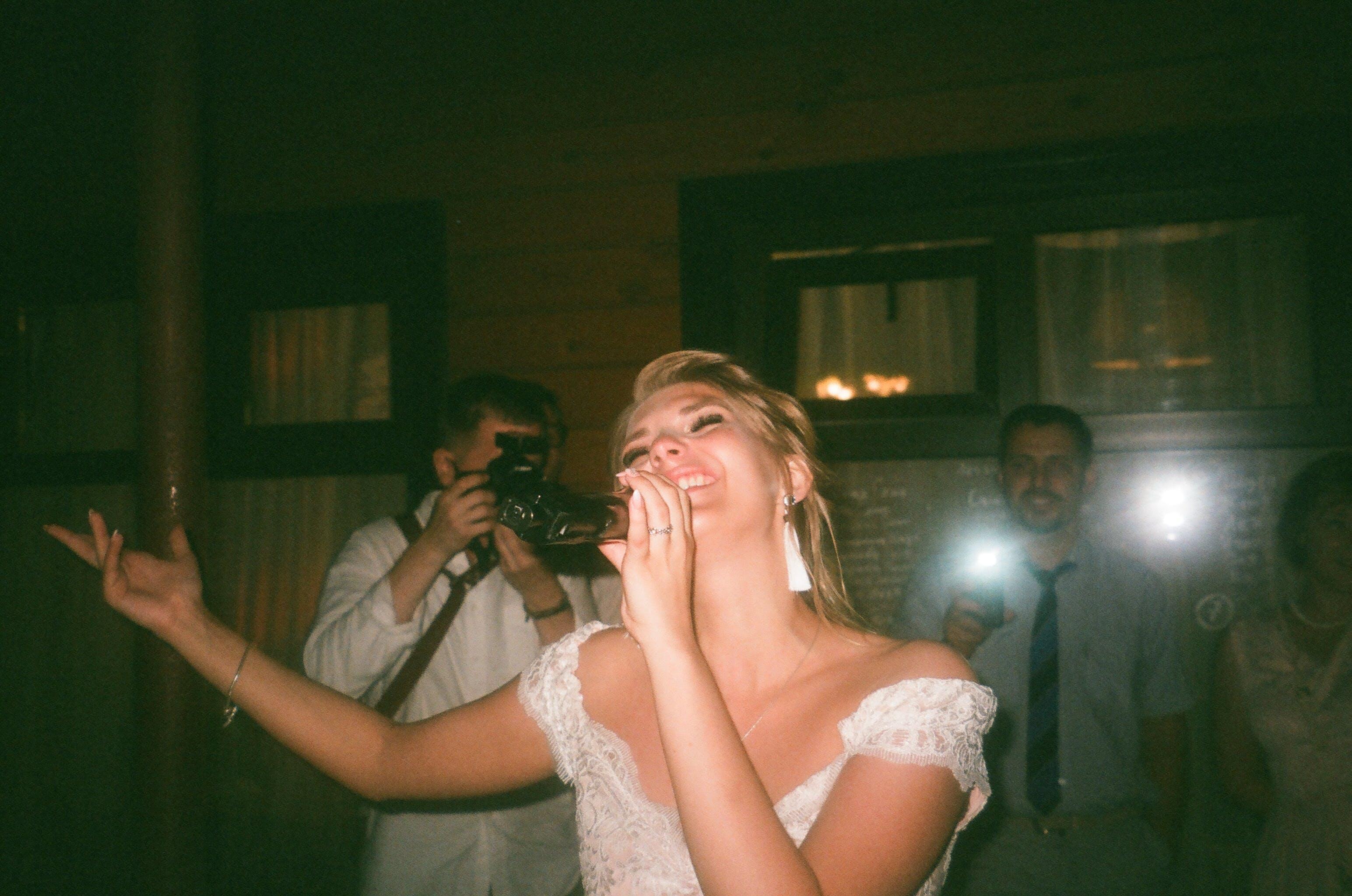 Woman Wearing White Dress While Singing
