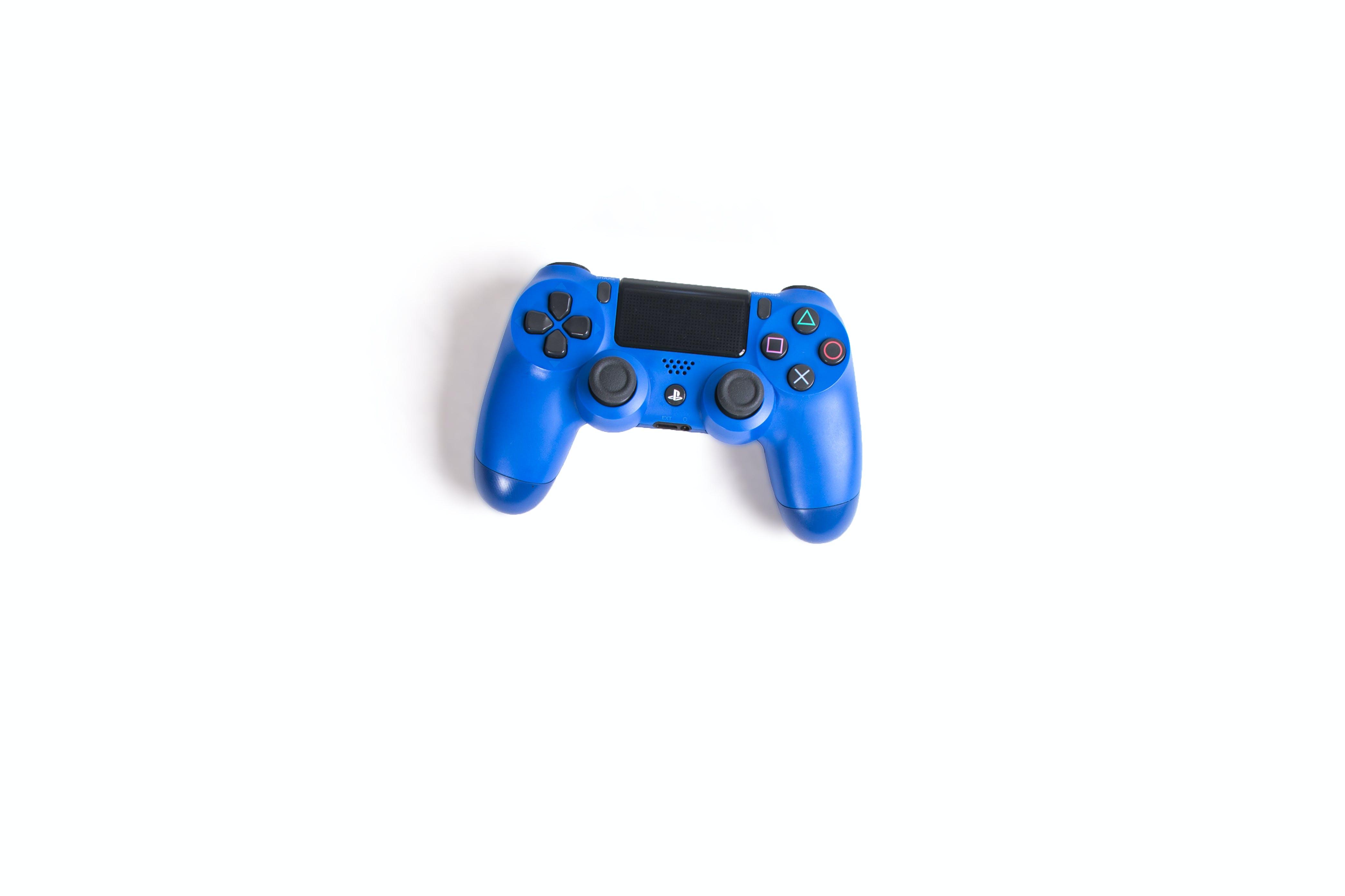 Blue Sony Dualshock 4 on White Surface