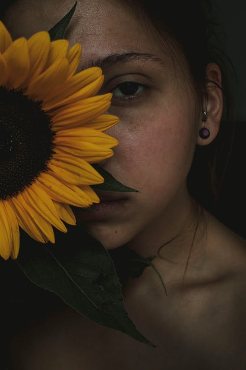 Woman Hiding on Sunflower Photography