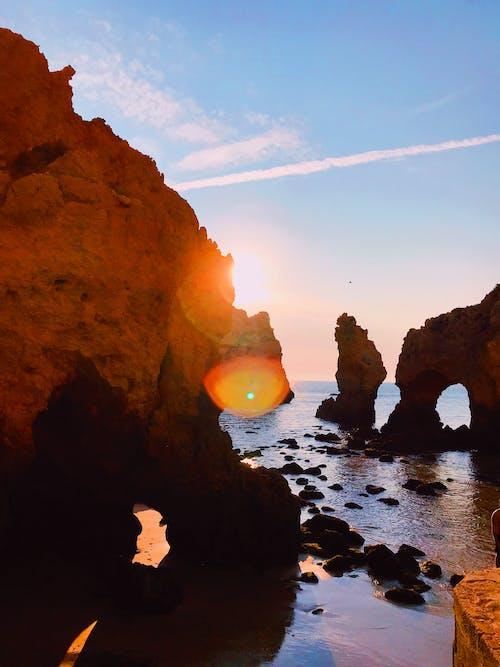 Photos gratuites de à contre-jour, bord de mer, cailloux, ciel
