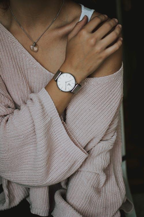 Woman Wearing Beige Crochet Sweater and Round White Analog Watch Closeup Photo
