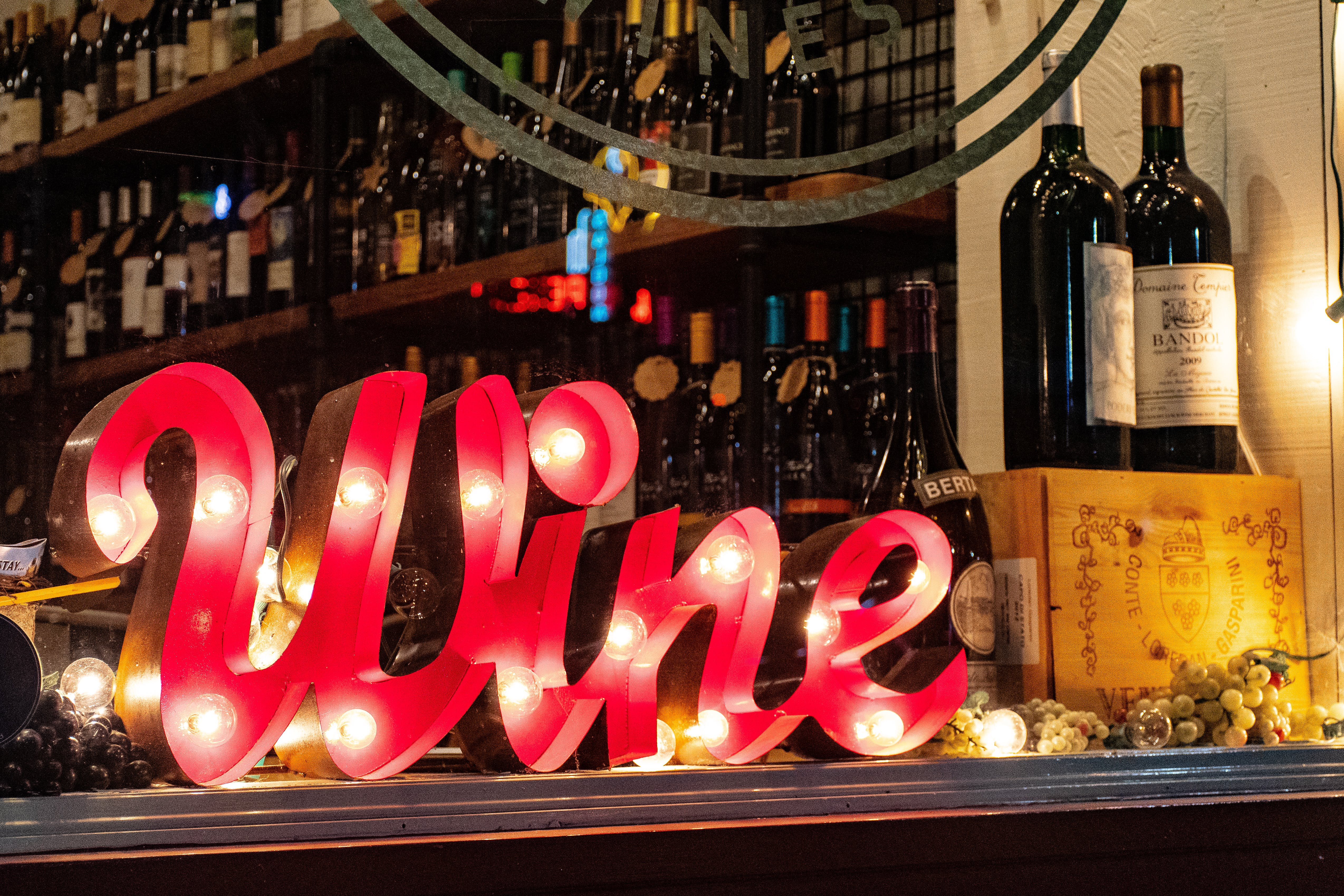 Red Wine Marquee Signage on Table
