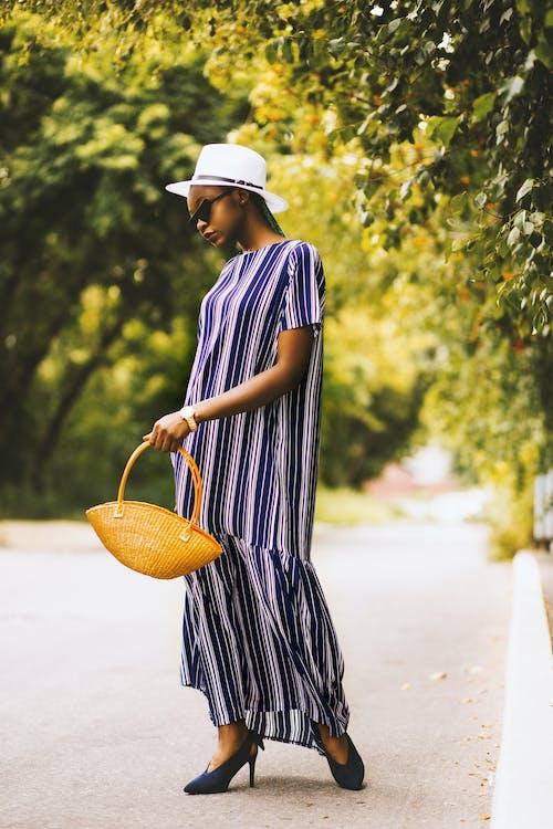 Woman Holding Brown Shoulder Bag