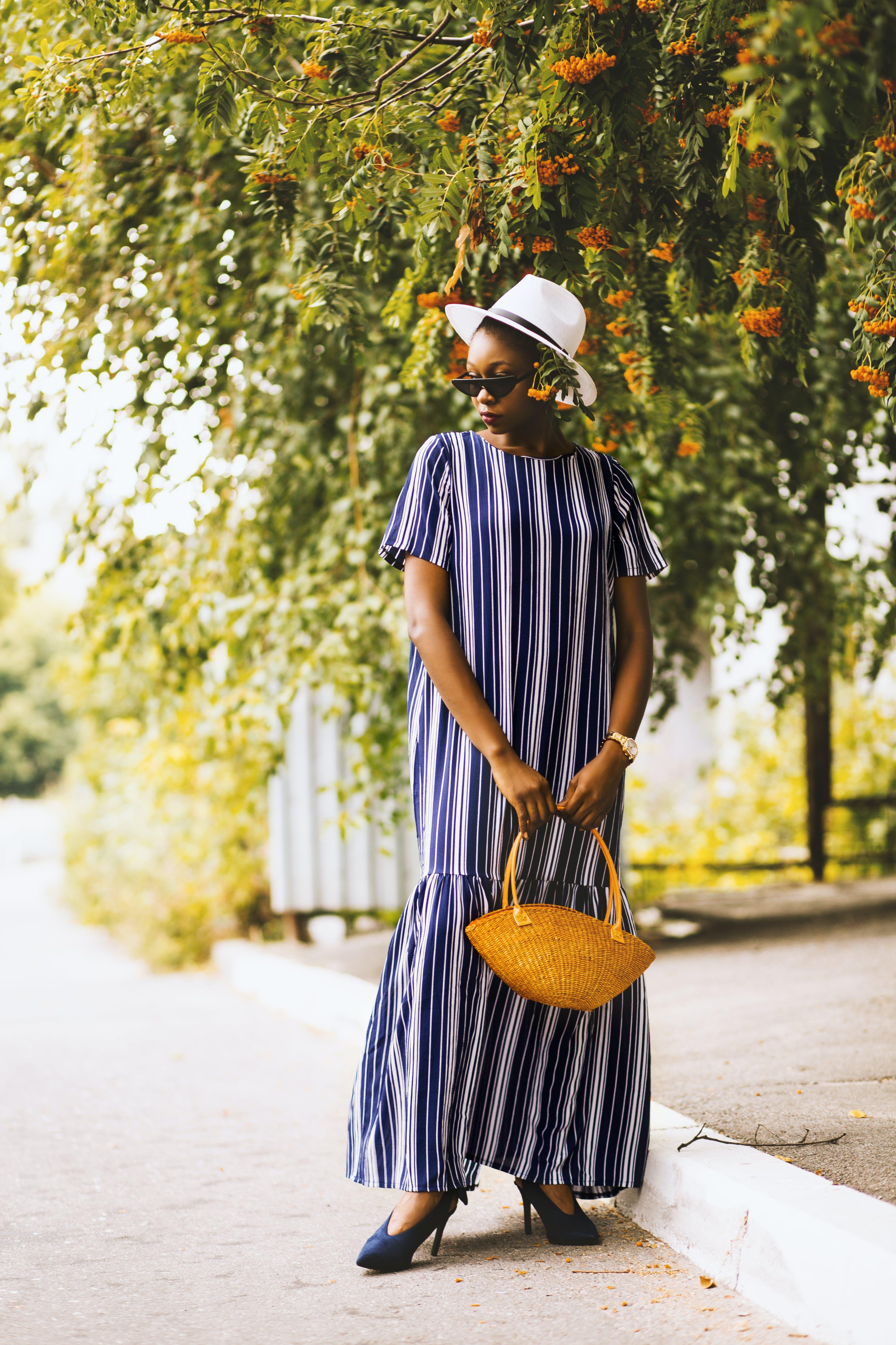 Woman Wearing Dress Holding Basket