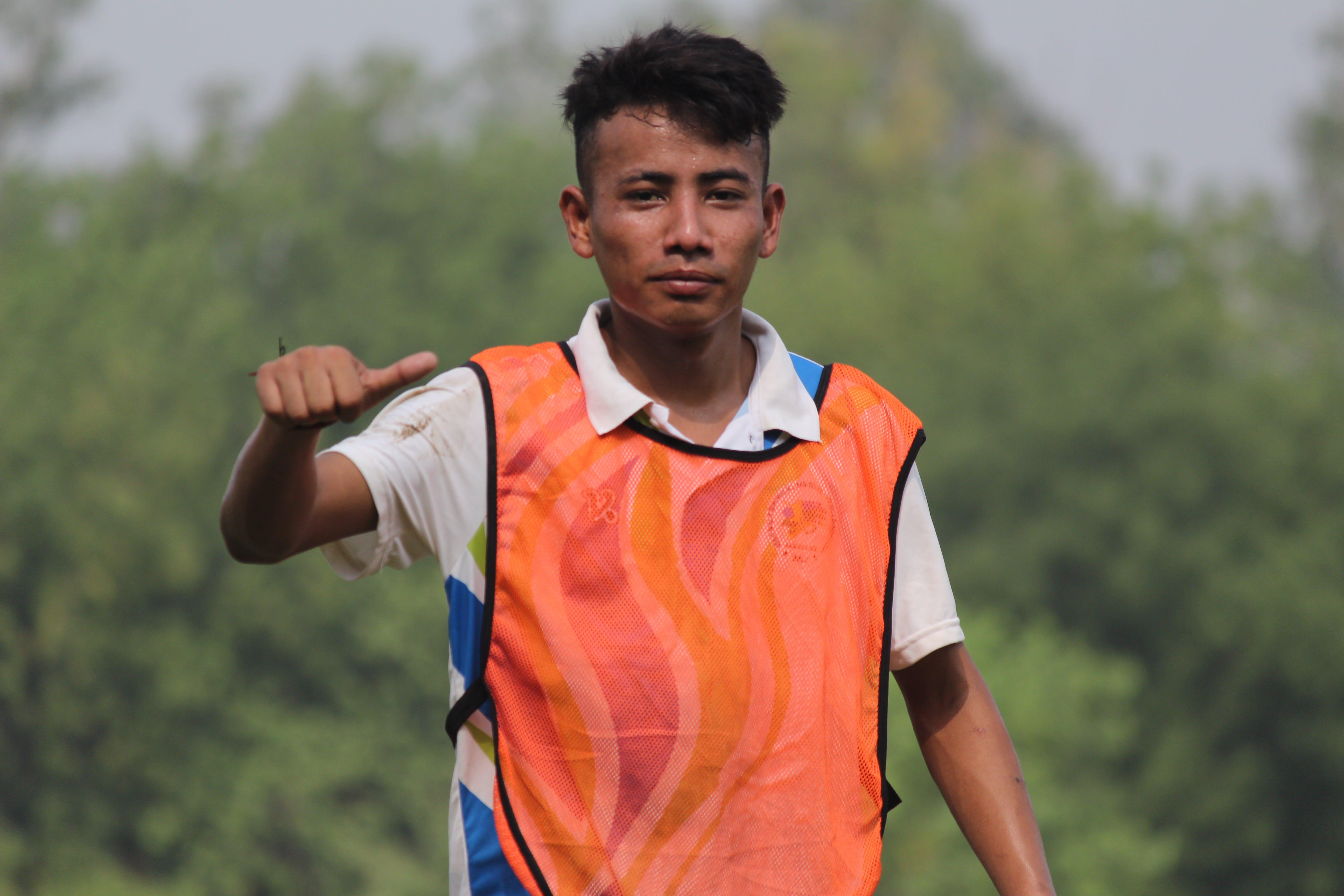 Man In Orange And White Shirt