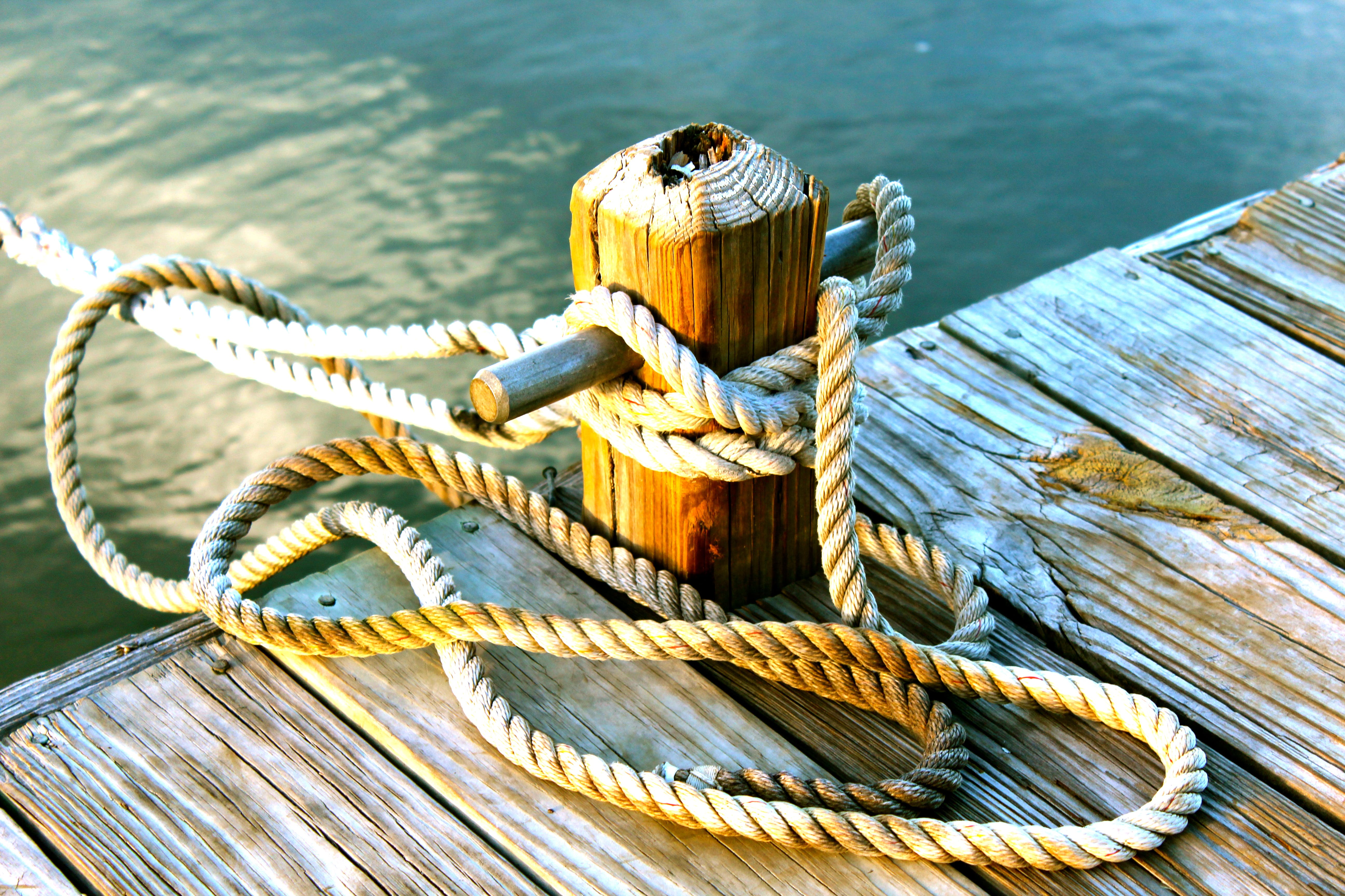 Brown Wooden Dock With Post Tied With Brown Rope