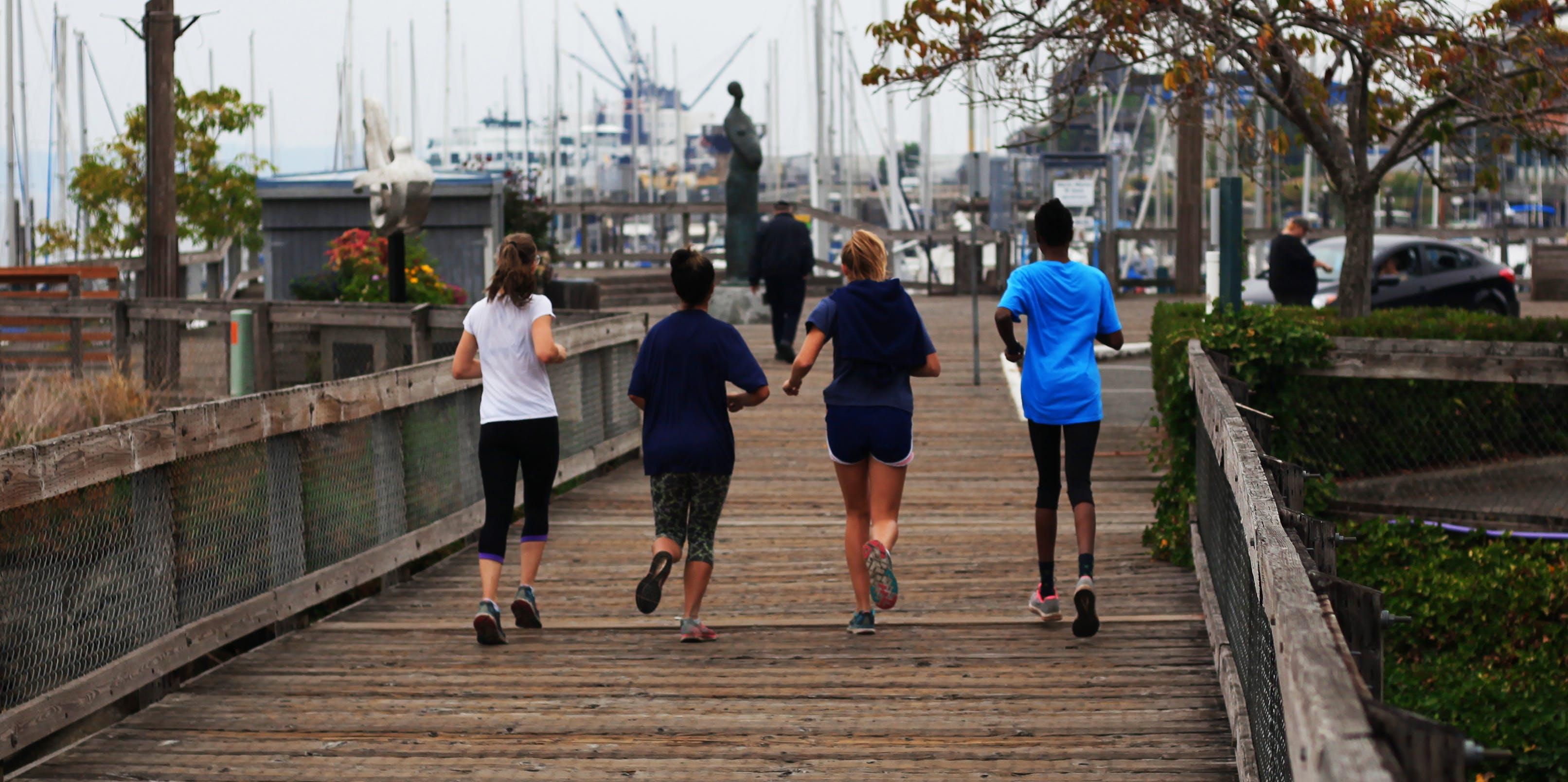 Free stock photo of jogging women waterfront