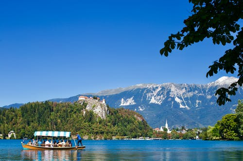 Free stock photo of alps, bled, blue sky, boat
