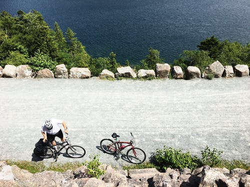 Fotos de stock gratuitas de aventura, ciclista, desde arriba, foto aérea
