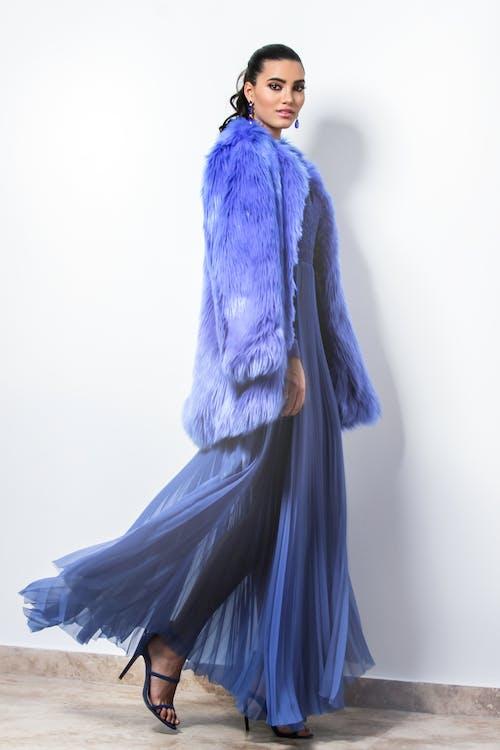 Woman Wearing Blue Fur Coat And Dress